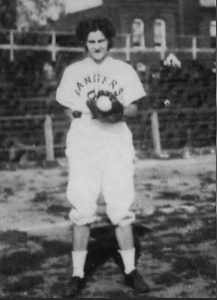 black and white image of 18 year old woman in baseball uniform